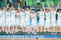 Winning team of Lithuania celebrate during Trophy ceremony after the basketball match between National teams of Lithuania and France in final match of U20 Men European Championship Slovenia 2012, on July 22, 2012 in SRC Stozice, Ljubljana, Slovenia. Lithuania defeated France 50-49 and became European Champion 2012. (Photo by Vid Ponikvar / Sportida.com)