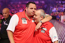 13.06.2015, Eissporthalle, Frankfurt, GER, Darts World Cup of Nations 2015, Frankfurt, im Bild Phil Taylor (England), Spitzname : The Power,gratuliert seinen Teamkollegen Adrian Lewis (England) zum Sieg // during the Darts World Cup of Nations 2015 at the Eissporthalle in Frankfurt, Germany on 2015/06/13. EXPA Pictures © 2015, PhotoCredit: EXPA/ Eibner-Pressefoto/ Roskaritz<br /> <br /> *****ATTENTION - OUT of GER*****