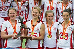 30-06-2012 LACROSSE: EUROPEES KAMPIOENSCHAP ENGELAND - WALES: AMSTERDAM<br /> (L-R) Team England with gold medals and trophy, 2 captain Katy Bennett, 25 Lucy Lynch, Leah Templeman, Keely Watt ENG. England wins the gold medal match against Wales<br /> ©2012-FotoHoogendoorn.nl / Peter Schalk