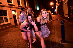 © London News Pictures. 01/01/2017. Aberystwyth, UK.  Two young women out celebrating the 2017 New Year in Aberystwyth, Wales, UK on January 01, 2017 in the early hours of the morning. Photo credit: Keith Morris/LNP