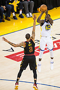 Golden State Warriors forward Draymond Green (23) shoots a three pointer over Cleveland Cavaliers guard George Hill (3) during Game 1 of the NBA Finals at Oracle Arena in Oakland, Calif., on May 31, 2018. (Stan Olszewski/Special to S.F. Examiner)