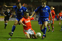 Fotball<br /> England 2004/22005<br /> Foto: SBI/Digitalsport<br /> NORWAY ONLY<br /> <br /> Blackpool v Leicester City<br /> FA Cup Third Round Replay. 18/01/2005. <br /> <br /> Keigan Parker of Blackpool tumbles in the box under pressure from Nikos Dabizas and Alan Maybury of Leicester City.