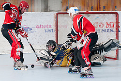 Primoz Puksic of Troha Pub Bled covers a puck at final match of IZS Masters 2011 inline hockey between Troha Pub Bled and HK Prevoje, on June 4, 2011 in Sportni park, Horjul, Slovenia. (Photo by Matic Klansek Velej / Sportida)