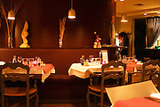 Interior of The restaurant Brunel at night. Tables with glasses, knives, ofrks, glasses. Candles.  Avignon, Vaucluse, Provence, Alpes Cote d Azur, France, Europe