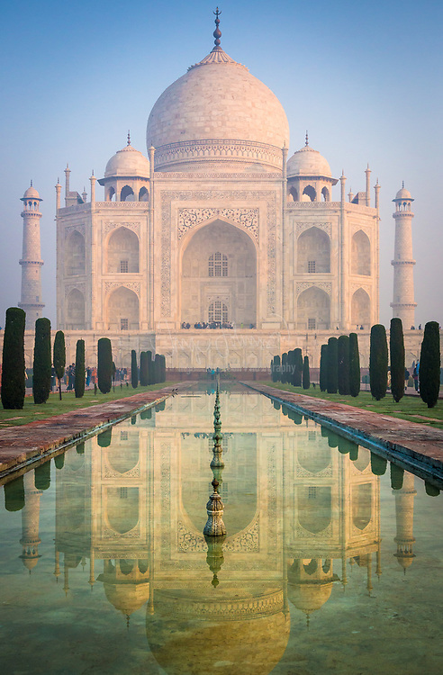 """The Taj Mahal is a white marble mausoleum located in Agra, Uttar Pradesh, India. It was built by Mughal emperor Shah Jahan in memory of his third wife, Mumtaz Mahal. The Taj Mahal is widely recognized as """"the jewel of Muslim art in India and one of the universally admired masterpieces of the world's heritage"""". Taj Mahal is regarded by many as the finest example of Mughal architecture, a style that combines elements from Islamic, Persian, Ottoman Turkish and Indian architectural styles. In 1983, the Taj Mahal became a UNESCO World Heritage Site. While the white domed marble mausoleum is the most familiar component of the Taj Mahal, it is actually an integrated complex of structures. The construction began around 1632 and was completed around 1653, employing thousands of artisans and craftsmen. The construction of the Taj Mahal was entrusted to a board of architects under imperial supervision, including Abd ul-Karim Ma'mur Khan, Makramat Khan, and Ustad Ahmad Lahauri. Lahauri is generally considered to be the principal designer."""