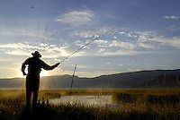 Travis Goodman of Wilson casts for cutthroat trout at sunrise on Sunday morning. Fishing on the stretch of the creek in the National Elk Refuge opened August 1.