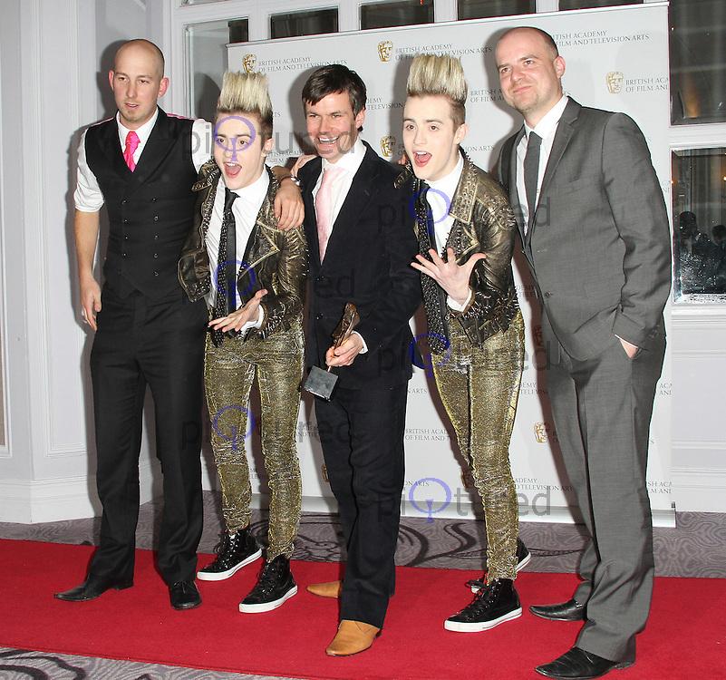 LONDON - NOVEMBER 25: Jedward attended the British Academy Children's Awards at the London Hilton, Park Lane, UK. November 25, 2012. (Photo by Richard Goldschmidt)