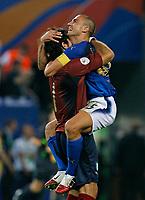 Photo: Glyn Thomas.<br />Italy v Ukraine. Quarter Finals, FIFA World Cup 2006. 30/06/2006.<br /> Italy's Fabio Cannavaro (R) celebrates with goalkeeper Gianluigi Buffon after reaching the semi-finals.