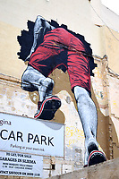 Mural in Sliema, person getting out of the car park on a wall