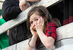 London, March 13th 2016. The annual St Patrick's Day Parade takes place in the Capital with various groups from the Irish community as well as contingents from other ethnicities taking part in a procession from Green Park to Trafalgar Square.  PICTURED: A girl waits for the parade to begin. ©Paul Davey<br /> FOR LICENCING CONTACT: Paul Davey +44 (0) 7966 016 296 paul@pauldaveycreative.co.uk
