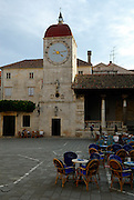John Paul II Square (Trg Ivana Pavla II), with Church of Saint Barbara (Crvca Sveti Barbara), Clock Tower of Church of Saint Sebastian (Crvca Sveti Sebastijan) and Loggia. Trogir, Croatia