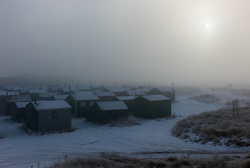 © Licensed to London News Pictures. 17/01/2013..South Gare, Teesside, England..An ice cold winter fog blankets the Fisherman's Huts in an area known as South Gare on Teesside...Photo credit : Ian Forsyth/LNP
