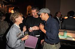 Left to right, PATTI PALMER-TOMKINSON, RUPERT EVERETT and GERRY DEVEAUX at a party to celebrate the publication of Inheritance by Tara Palmer-Tomkinson at Asprey, 167 New Bond Street, London on 28th September 2010.