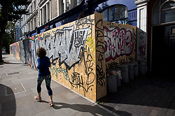 © Licensed to London News Pictures. 30/08/2020. London, UK. Shops boarded up in Notting Hill, West London, on the day of the 2020 Notting Hill Carnival which is bing held virtually this year due to COVID-19 restrictions. Members of the public have been warned against congregating in the Notting Hill Area to celebrate the event. Photo credit: Ben Cawthra/LNP