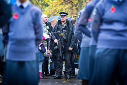 © Licensed to London News Pictures. 11/11/2018. Doncaster UK. An armed Police officer at the Service of remembrance at the Cenotaph in Doncaster to mark the 100th anniversary of the end of the First World War. Photo credit: Andrew McCaren/LNP