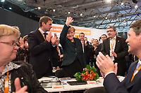 09 DEC 2014, KOELN/GERMANY:<br /> Vincent Kokert (L), CDU, Generalsekretaer der CDU MEcklenburg-Vorpommern, Angela Merkel (M), CDU, Bundeskanzlerin, und Lorenz Caffier (R), CDU Landesvorsitzender und Innenminister Mecklenburg-Vorpommern, nach der Bekanntgabe des Wahlergebnisses ihrer Wiederwahl zur Bundesvorsitzenden der CDU, CDU Bundesparteitag, Messe Koeln<br /> IMAGE: 20141209-01-097<br /> KEYWORDS: Wahl, Wahlergebnis, Party Congress, Applaus, applaudieren, klatschen, Jubel