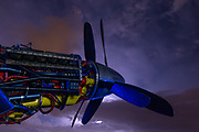 """The Rolls Royce Griffon V12 inside this P-51 Mustang """"Precious Metal"""" backlit by a summer lightning storm."""