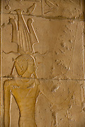 """Hieroglyphs on columns at the ancient Egyptian Temple of Hatshepsut near the Valley of the Kings, Luxor, Nile Valley, Egypt. The Mortuary Temple of Queen Hatshepsut, the Djeser-Djeseru, is located beneath cliffs at Deir el Bahari (""""the Northern Monastery""""). The mortuary temple is dedicated to the sun god Amon-Ra and is considered one of the """"incomparable monuments of ancient Egypt."""" The temple was the site of the massacre of 62 people, mostly tourists, by Islamists on 17 November 1997."""