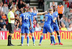 Leicester City's Wes Morgan (right) is booked for unsporting behaviour during the Premier League match at the Vitality Stadium, Bournemouth.