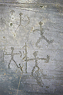 Prehistoric Petroglyph, rock carving, of  warriors with spears shields and a bow carved by the Camunni people in the iron age between 1000-1600 BC, Seradina I rock 12, Seradina-Bedolina Archaeological Park, Valle Comenica, Lombardy, Italy .<br /> <br /> Visit our PREHISTORY PHOTO COLLECTIONS for more   photos  to download or buy as prints https://funkystock.photoshelter.com/gallery-collection/Prehistoric-Neolithic-Sites-Art-Artefacts-Pictures-Photos/C0000tfxw63zrUT4<br /> If you prefer to buy from our ALAMY PHOTO LIBRARY  Collection visit : https://www.alamy.com/portfolio/paul-williams-funkystock/valcamonica-rock-art.html