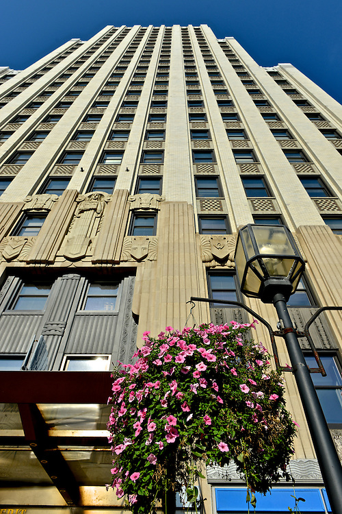 Flower pots hanging in front of the First Merit Tower in downtown Akron.
