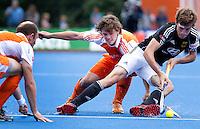 UTRECHT - De jarige Wouter Jolie stopt de Duitser Florian Fuchs , zaterdag tijdens de  hockey interland tussen de mannen van Nederland en Duitsland (4-2). links Teun de Nooijer. COPYRIGHT KOEN SUYK