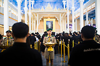 BANGKOK, THAILAND - October 26, 2017: Young boy scouts hold offerings for mourners at Wat Saket in Bangkok, Thailand. Hundreds of thousands of people, dressed in black, have gathered in Bangkok over a year after the death of Thailand's popular King Bhumibol Adulyadej.  The five-day royal cremation ceremony is taking place between October 25-29 in Bangkok's historic Grand Palace and the Sanam Luang area.