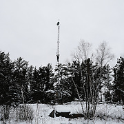 Richard Lajeunesse installing an additional transmitter on a tower providing Internet connectivity to the Ochiichagwe'Babigo'Ining Ojibway Nation reserve (also known as the Dalles First Nation) in Northern Ontario, Canada on 19 December 2016. Part of a project initiated by Chad Henry, then president of the band's youth council, the tower was established in 2013. According to residents it worked well initially, but service has been problematic since for a number of reasons, including heavy demand and storm damage. Lajeunesse is now working with the community's water treatment plant to provide them with a dedicated Internet link via the tower so that the plant can participate in a pilot program that will allow water quality to be monitored in real time from a central Water Hub being established at the Bimose Tribal Council in Kenora.