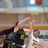 Newcomb Skyhawk Virlonoa Brown (21) and Wingate Bear Brittney Payton (22) both jump for possession of the ball Friday in the Holiday classic tournament in Wingate.