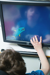 Child using touch screen computer,