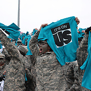 "Army personnel wave tee shirts supporting the ""It's On Us"" initiative, an awareness campaign to help put an end to sexual assault on college campuses during the Army Black Knights Vs Air Force Falcons, College Football match at Michie Stadium, West Point. New York. Air Force won the game 23-6. West Point, New York, USA. 1st November 2014. Photo Tim Clayton"