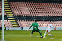 Football - 2020 / 2021 Emirates FA Cup - Round 2 - Barnet vs Milton Keynes Dons - The Hive<br /> <br /> Warren O'Hora (MK Dons) see's his shot beat Scott Loach (Barnet FC) only to hit the crossbar <br /> <br /> COLORSPORT/DANIEL BEARHAM
