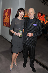 ED & CAROL VICTOR at a party to celebrate the publication of Can We Still Be Friends by Alexandra Shulman held at Sotheby's, 34-35 New Bond street, London on 28th March 2012.