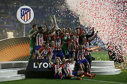 goalkeeper trainer Oscar Ortega of Club Atletico de Madrid, goalkeeper Jan Oblak of Club Atletico de Madrid, Diego Godin of Club Atletico de Madrid, Koke of Club Atletico de Madrid, Antoine Griezmann of Club Atletico de Madrid, Saul Niguez of Club Atletico de Madrid, Correa of Club Atletico de Madrid, Gabi of Club Atletico de Madrid, Sime Vrsaljko of Club Atletico de Madrid, Diego Costa of Club Atletico de Madrid, Lucas Hernandez of Club Atletico de Madrid, Jose Maria Gimenez of Club Atletico de Madrid, goalkeeper Axel Werner of Club Atletico de Madrid, Filipe Luis of Club Atletico de Madrid, Thomas Partey of Club Atletico de Madrid, Fernando Torres of Club Atletico de Madrid, Stefan Savic of Club Atletico de Madrid, Juanfran of Club Atletico de Madrid, Kevin Gameiro of Club Atletico de Madrid, coach Diego Simeone of Club Atletico de Madrid, coach German Burgos of Club Atletico de Madrid with UEFA Europa League trophy during the UEFA Europa League final match between Olympique Marseille and Atletico de Madrid at Stade de Lyon, on May 16, 2018 in Lyon, France
