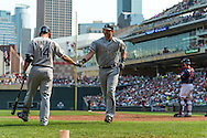 Adam Dunn #32 of the Chicago White Sox is is congratulated by teammate Paul Konerko #14 after hitting a home run on September 16, 2012 at Target Field in Minneapolis, Minnesota.  The White Sox defeated the Twins 9 to 2.  Photo: Ben Krause