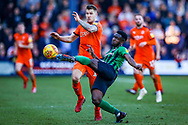 Coventry City defender Brandon Mason (3) sweeps the ball away from Luton Town forward James Collins during the EFL Sky Bet League 1 match between Luton Town and Coventry City at Kenilworth Road, Luton, England on 24 February 2019.