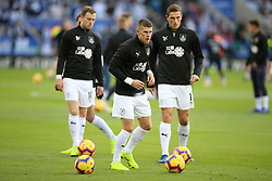 Burnley's Johann Gudmundsson and Chris Wood (right) warm up prior to the match
