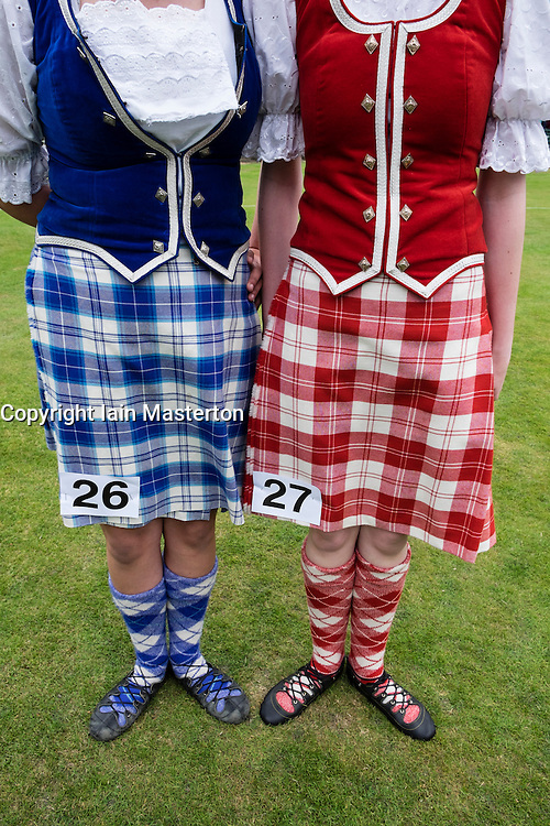 Female highland dancers in kilts before competition at  Braemar Junior Highland Games in July in Scotland United Kingdom