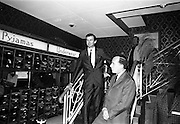 17/07/1967<br /> 07/17/1967<br /> 17 July 1967<br /> Opening of new men's salon at Brown Thomas, Grafton Street, Dublin. Brendan O'Reilly, the TV personality opened a new Mens Department in Brown Thomas and Co. Ltd.. In the new department was a hairdressing salon where while getting your hair done it was possible to make phone calls from the chair. Image shows Brendan O'Reilly (left) speaking at the opening with Mr. John McGuire, Managing Director, Brown Thomas Group.