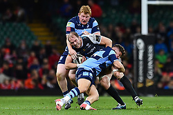 27th April 2019 , Principality Stadium , Cardiff, Wales ; Guinness pro 14's, Round 21, Cardiff Blues Vs Ospreys ; Alun Wyn Jones of Ospreys is tackled by Kirby Myhill of Cardiff Blues<br /> <br /> Credit :  Craig Thomas/Replay Images