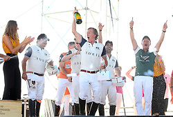 ROVINJ, June 10, 2018  Members of Adris Team, Bruce Colley holding bottle of champagne, Guillermo Steta (L), and Juan Clemente Marambio (R) celebrate on the podium after winning at the Rovinj Beach Polo Cup 2018 in Rovinj, Croatia on June 10, 2018. Adris Team defeted Muller Team by 7:5. (Credit Image: © Jurica Galoic/Xinhua via ZUMA Wire)