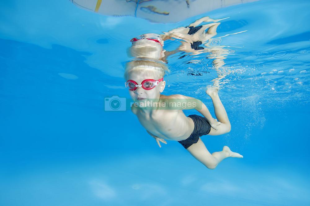 September 18, 2016 - Odessa, Ukraine - 5 years boy in a swimming goggles learning to swim underwater in the pool (Credit Image: © Andrey Nekrasov/ZUMA Wire/ZUMAPRESS.com)