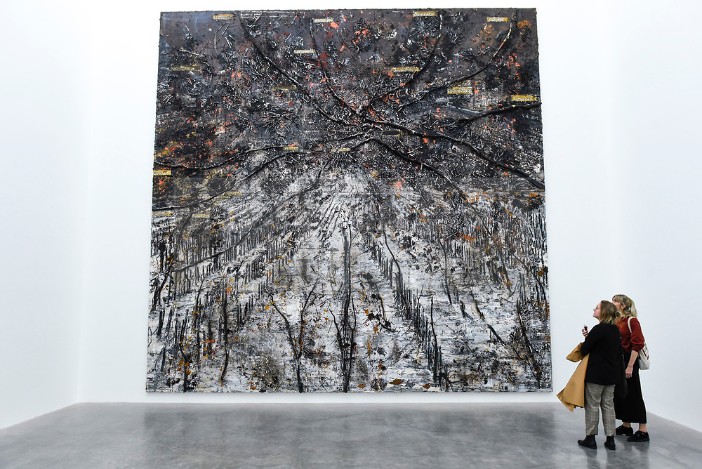 """© Licensed to London News Pictures. 14/11/2019. LONDON, UK. Visitors view """"Ramanujan Summation"""" 1/12, 2018-2019, by Anselm Kiefer at the preview of a new exhibition called """"Superstrings, Runes, The Norns, Gordian Knot"""" by Anselm Kiefer.  The works include large scale paintings and installations that draw on the scientific concept of string theory and are on display at the White Cube Gallery in Bermondsey 15 November to 26 January 2020.  Photo credit: Stephen Chung/LNP"""