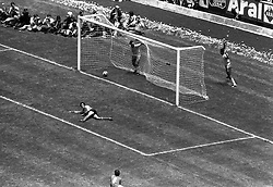 21 June 1970 - FIFA World Cup Final - Brazil v Italy - Brazil captain Carlos Alberto (4) runs off to celebrate scoring Brazils fourth and final goal with teammate Tostao in the net.