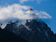 See the top of Aiguille du Midi (3842 meters or 12,605 feet) téléphérique station (cable car, aerial tramway, or Seilbahn) from Chamonix, France, the Alps, Europe. It is the highest vertical ascent cable car in the world, from 1035 meters to 3842 m.