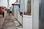 A girl living at Konik Camp located in the suburbs of the city of Podgorica, Montenegro. A huge fire in 2012 detroyed a big part of the refugee camp and many of the inhabitants are living in containers. The housing pictured belongs to the part with new housing facilities.