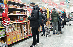© Licensed to London News Pictures. 24/12/2020. London, UK. Shoppers in Morrison supermarket in north London doing last minute shopping on Christmas Eve. The government has announced that a new COVID-19 mutation has been discovered in the UK in people who travelled from South Africa. As coronavirus continues to spread more areas will go into Tier 4 from Boxing Day. Photo credit: Dinendra Haria/LNP