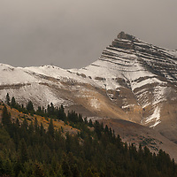 A striated mountain rises in the Canadian Rockies.