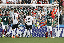 MOSCOW, June 17, 2018  Goalkeeper Guillermo Ochoa (1st R) of Mexico defends during a group F match between Germany and Mexico at the 2018 FIFA World Cup in Moscow, Russia, June 17, 2018. (Credit Image: © Cao Can/Xinhua via ZUMA Wire)