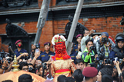 September 15, 2016 - Kathmandu, Nepal - Devotees carrying God 'Bhairab' as seen traditional decorated flower for the chariot pulling festival on the third day of Indra Jatra Festival celebrated at Basantapur Durbar Square, Kathmandu. Devotees celebrated the god of rain 'Indra' for 8 days in Kathmandu. (Credit Image: © Narayan Maharjan/Pacific Press via ZUMA Wire)